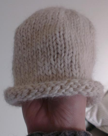 Photograph of a hand-knitted baby's hat by Hannah Foley. All rights reserves (www.owlingabout.co.uk)