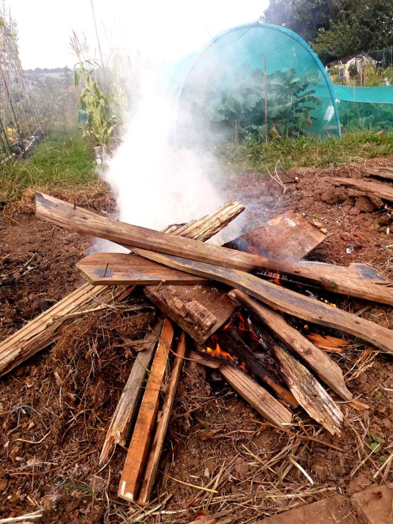 Photograph of a bonfire on an allotment by Hannah Foley. All rights reserved (www.owlingabout.co.uk)