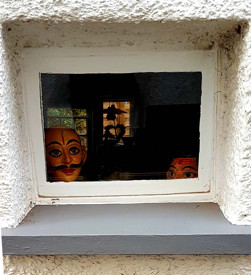 A mask though a window.