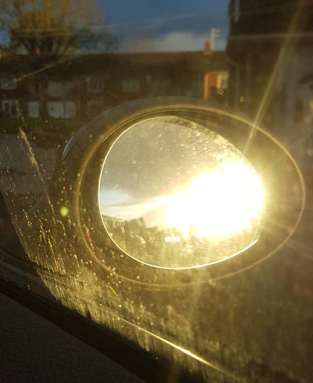 Photograph of low sun in car wing mirror by Hannah Foley. All rights reserved (www.hannah-foley.co.uk)